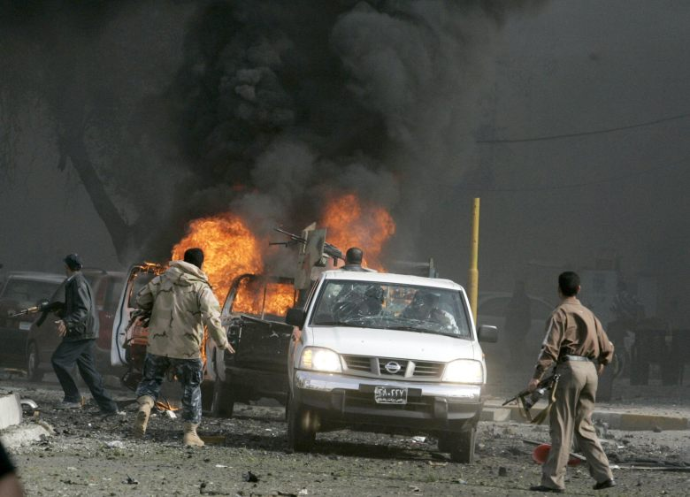 Cars burn at the scene of a car bomb attack in Baghdad